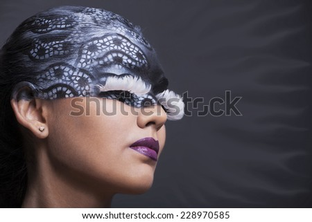 close-up portrait of a beautiful girl with interesting makeup - stock photo
