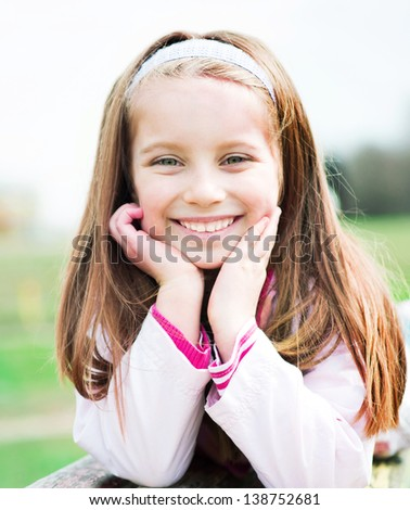 Close-up portrait of a beautiful liitle girl - stock photo