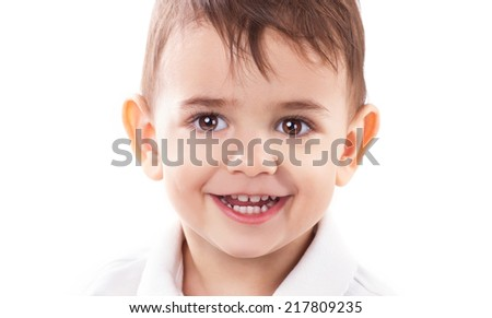 close-up portrait of a beautiful little boy with brown eyes and long eyelashes on white background - stock photo