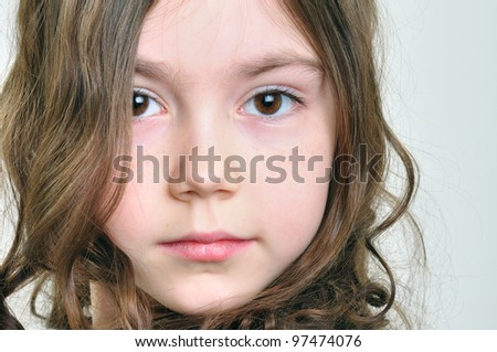 close-up portrait of a beautiful  little  girl with long brown hair - stock photo
