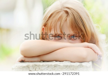 Close-up portrait of a beautiful little girl with sparkling eyes and smile - stock photo