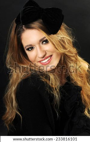 close up portrait of a beautiful long haired blond teenage girl with a beautiful smile and perfect teeth wearing a velvet ribbon hairband - stock photo