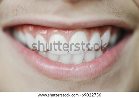 Close-up portrait of a beautiful male smile - stock photo