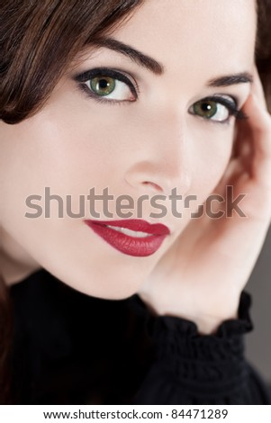 Close-up portrait of a beautiful middle aged woman with beautiful red lips - stock photo