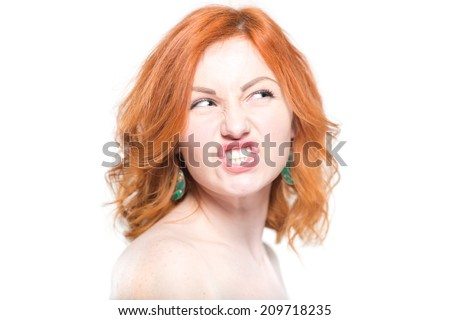 Close-up portrait of a beautiful redhead woman, grin. Isolated on white background. Facial expression and emotions. - stock photo