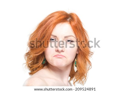 Close-up portrait of a beautiful redhead woman, sad. Isolated on white background. Facial expression and emotions. - stock photo