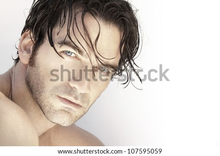 Close up portrait of a beautiful sexy male model face against white background