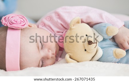 close-up portrait of a beautiful sleeping baby - stock photo