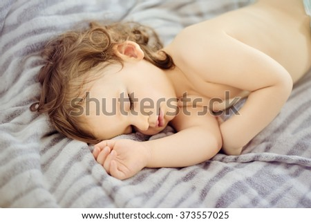 Close-up portrait of a beautiful sleeping baby. Cute infant kid. Child portrait in pastel tones. The beautiful baby could be a boy or girl - stock photo