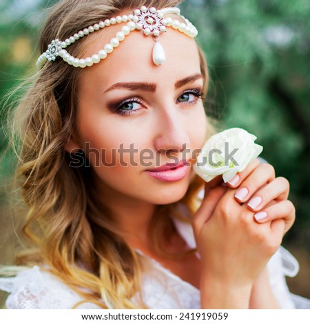 Close up portrait of a beautiful smiling bride with perfect skin .  Gorgeous  woman posing in her wedding day in the forest . - stock photo