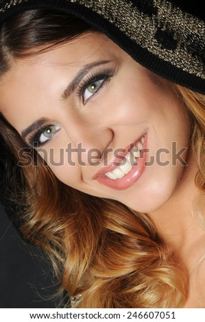 close up portrait of a beautiful smiling caucasian girl with long curly hair  - stock photo