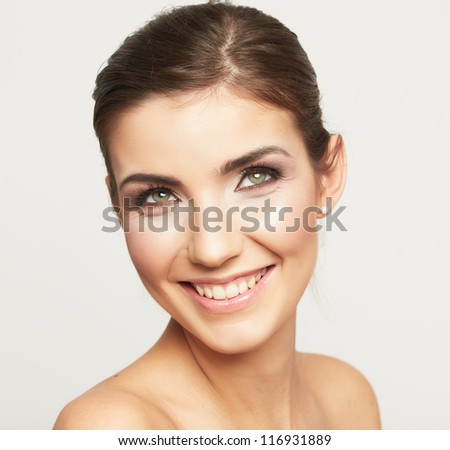 Close up portrait of a beautiful smiling woman isolated against white background - stock photo