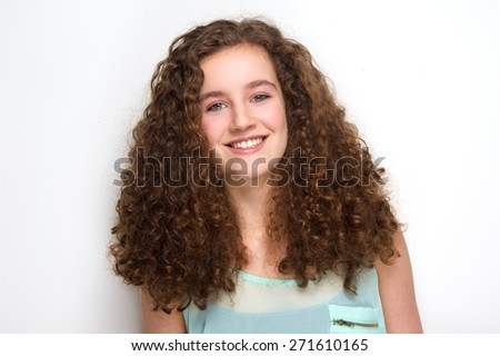 Close up portrait of a beautiful teenage girl with curly hair posing on white background - stock photo