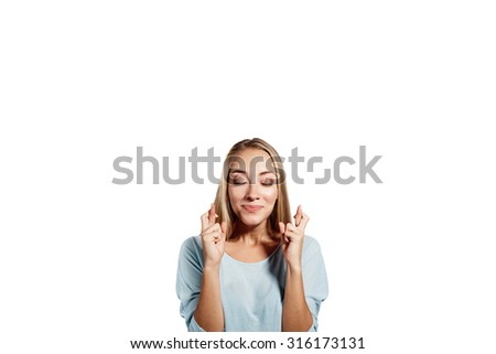 Close-up portrait of a beautiful woman closing her eyes, crossing her fingers hoping for the best,isolated on white background - stock photo