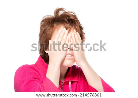 Close-up portrait of a beautiful woman, covering her eyes. Isolated on white background. Facial expression and emotions.