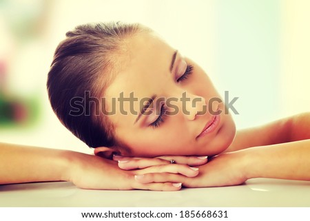Close-up, portrait of a beautiful woman getting ready for the spa treatment - stock photo