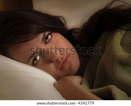 Close up portrait of a beautiful Woman In Bed - stock photo