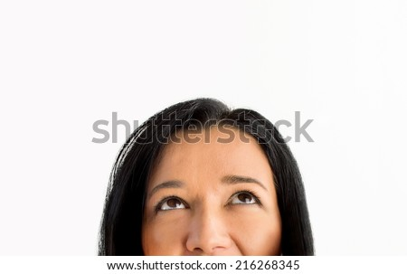 Close up portrait of a beautiful woman looking up into the corner and  lots of copyspace and room for text on this isolate - stock photo