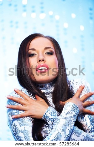 Close-up portrait of a beautiful woman over abstract background