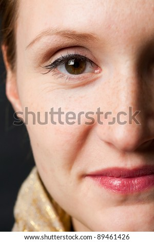 Close-up portrait of a beautiful woman. Studio shot. - stock photo