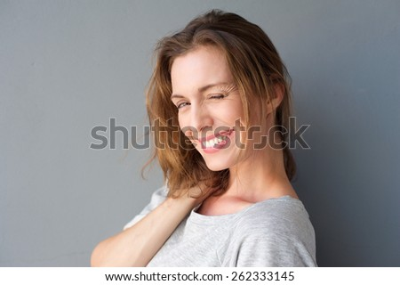 Close up portrait of a beautiful woman winking her eye and flirting - stock photo