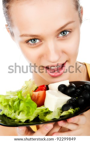 close-up portrait of a beautiful woman with a plate of vegetable salad, Greek salad, vegetarian food