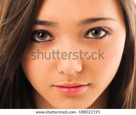 Close-up portrait of a beautiful young Asian woman. - stock photo