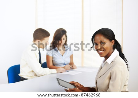 Close up portrait of a beautiful young black businesswoman with a Tablet PC. - stock photo