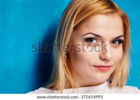 Close up portrait of a beautiful young blond woman. - stock photo