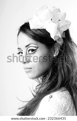 close up portrait of a beautiful Young girl wearing ribbon hair band and scenic make up isolated on White in black and white