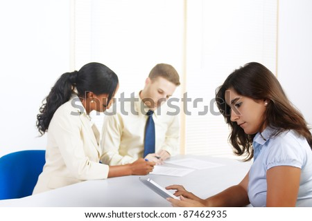 Close up portrait of a beautiful young Hispanic businesswoman using a tablet PC. - stock photo