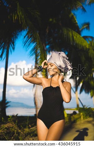 close-up portrait of a beautiful young sensual sexy woman with a turban on his head and African   full lips and expressive eyes on a sunny day at sunset in the tropical hot jungle in Thailand by sea - stock photo
