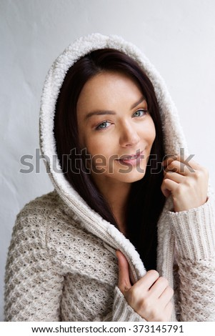 Close up portrait of a beautiful young woman in warm sweater