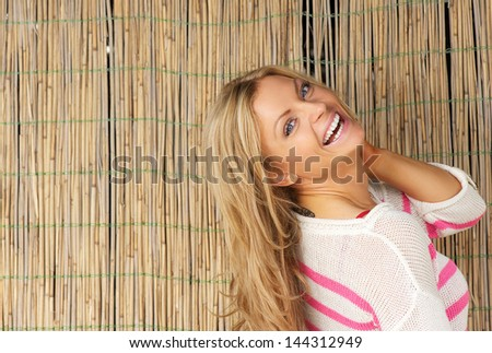 Close up portrait of a beautiful young woman laughing outdoors
