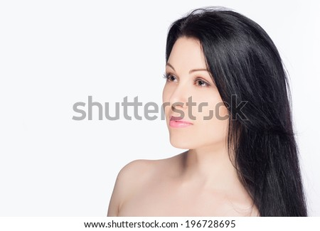 Close-up portrait of a beautiful young woman. Skin care concept. Natural look. Beauty portrait. Spa and health. Beautiful long hair.