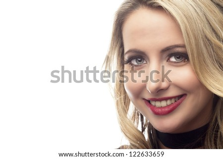 Close-up portrait of a beautiful young woman smiling over white background,