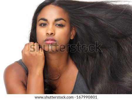 Close up portrait of a beautiful young woman with flowing hair - stock photo