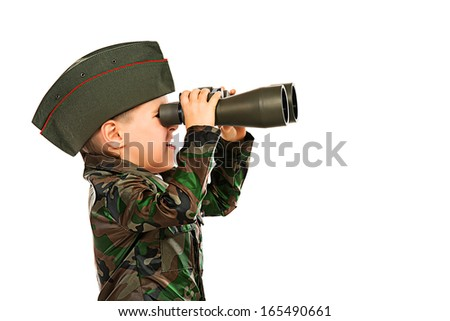 Close-up portrait of a boy dressed like a soldier looking in the binoculars. Different occupations. Isolated over white.
