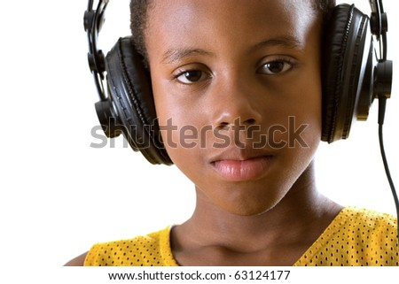 close-up portrait of a boy listening to soothing music on headphones - stock photo