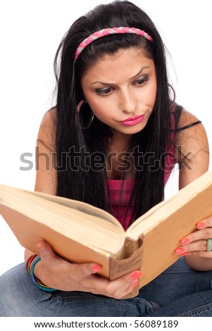 Close up portrait of a brunette teenage girl reading a book