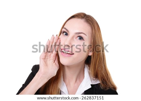 Close up portrait of a business woman whisper (tells) a gossip. Isolated on white background, caucasian beauty - stock photo
