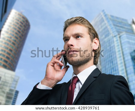 Close-up portrait of a businessman talking on the phone