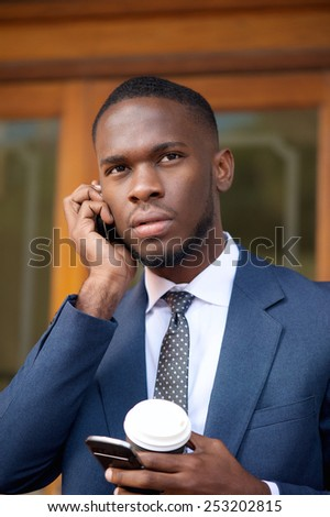 Close up portrait of a busy businessman talking on cellphone  - stock photo