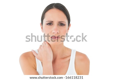 Close-up portrait of a casual young woman suffering from neck ache over white background - stock photo