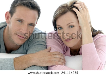 Close up portrait of a Caucasian Couple in love - Man and woman lying down in front of camera - They are in their thirties. - stock photo