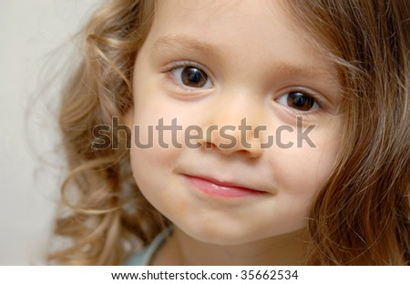 Close-up portrait of a caucasian smiling girl.