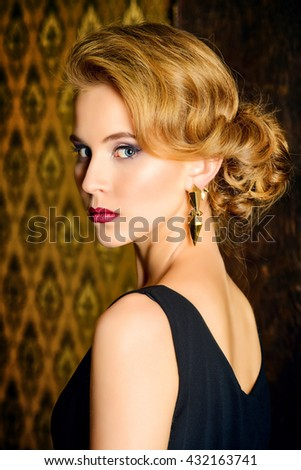 Close-up portrait of a charming young woman with evening make-up and hairstyle over vintage background. Beauty, fashion. Make-up. - stock photo