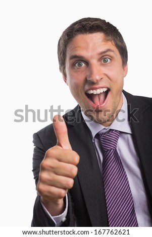 Close-up portrait of a cheerful businessman gesturing thumbs up over white background - stock photo