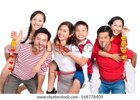 Close up portrait of a cheerful family having fun with Tet decorations isolated on white