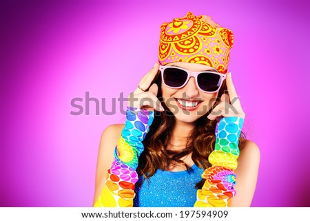 Close-up portrait of a cheerful teenager girl in bright casual clothes smiling at the camera with beautiful smile.  - stock photo